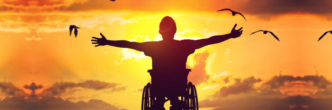 man on a wheelchair enjoying the sunset